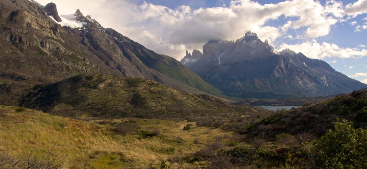 Beautiful scenery of mountains under the cloudy sky in Torres del Paine National Park, Chile
